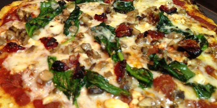 Cauliflower Crust Pizza Topped With Spinach, Mushrooms, Sundried Tomatoes and Feta
